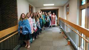 seniors with quilts and pastors